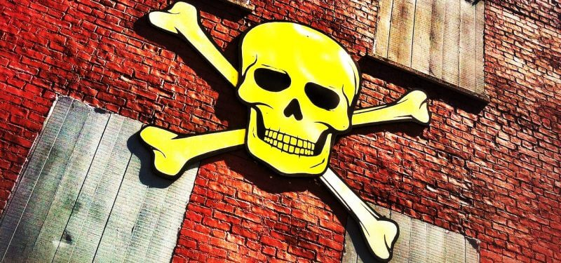 Skull and crossbones on a brick building