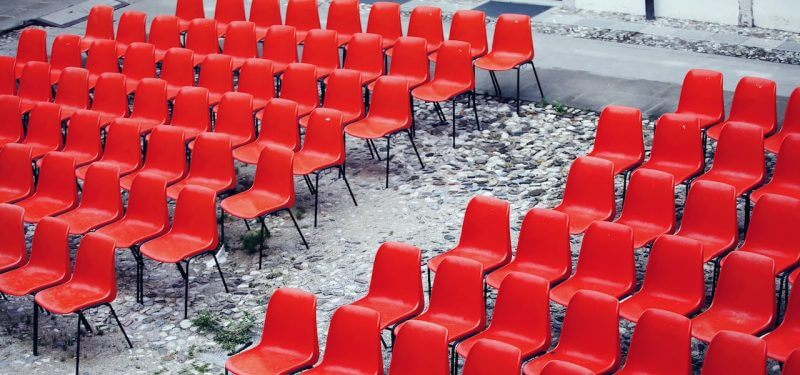 Rows of empty red chairs