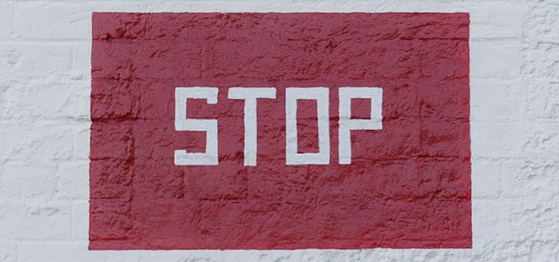 Stop sign painted on a wall
