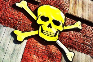 Skull and crossbones on a brick building