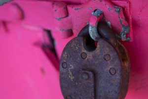 Lock on a pink background