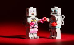 Lego robots holding hands