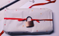 Present wrapped with a lock tied to the bow