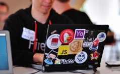 Laptop with stickers including JS logo