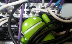 Android mascot tangled in ethernet cords